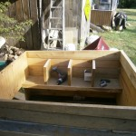 The nesting boxes.  Single shelf with three dividers to make four nesting boxes.